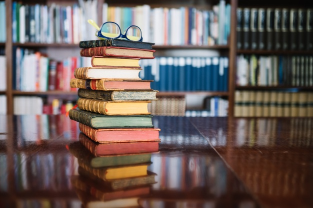 stack-of-old-books-in-library_23-2147711453
